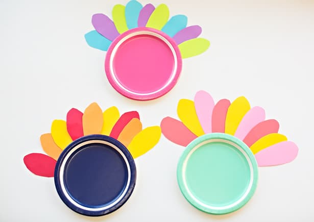 Glue or tape your feathers and googley eyes. You can also cut out a triangle for nose and use red paper to cut out a wattle (the red flap on a turkey). & COLORFUL TURKEY PAPER PLATE CRAFT