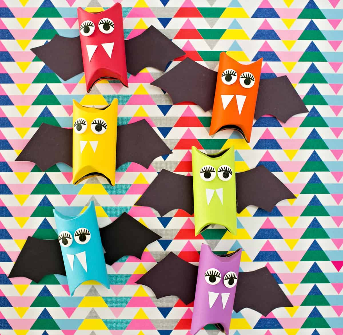 these adorable rainbow paper tube bats are simple to make and double as colorful halloween decorations for your home or as halloween favors simply add