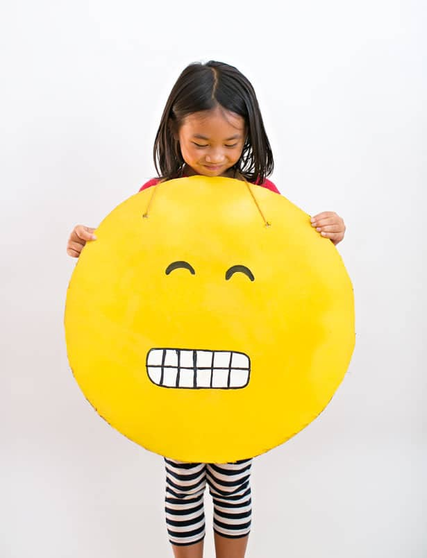 Easy diy cardboard emoji costume look up your favorite emojis and hand draw features with a pencil on your cardboard faces paint in the details using various sized paint brushes solutioingenieria Gallery