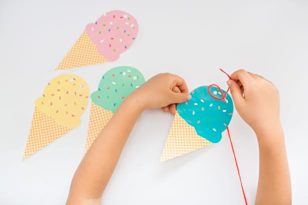 Hello wonderful free printable ice cream cone garland simply cut out your ice cream cone shapes hole punch two holes at the top and string yarn or string through them to make a garland pronofoot35fo Choice Image