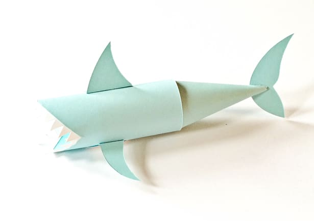hello wonderful shark paper tube craft next glue the arm fins to a paper circle cutout and then the circle to the belly of the shark glue on the back fin and the cone tail