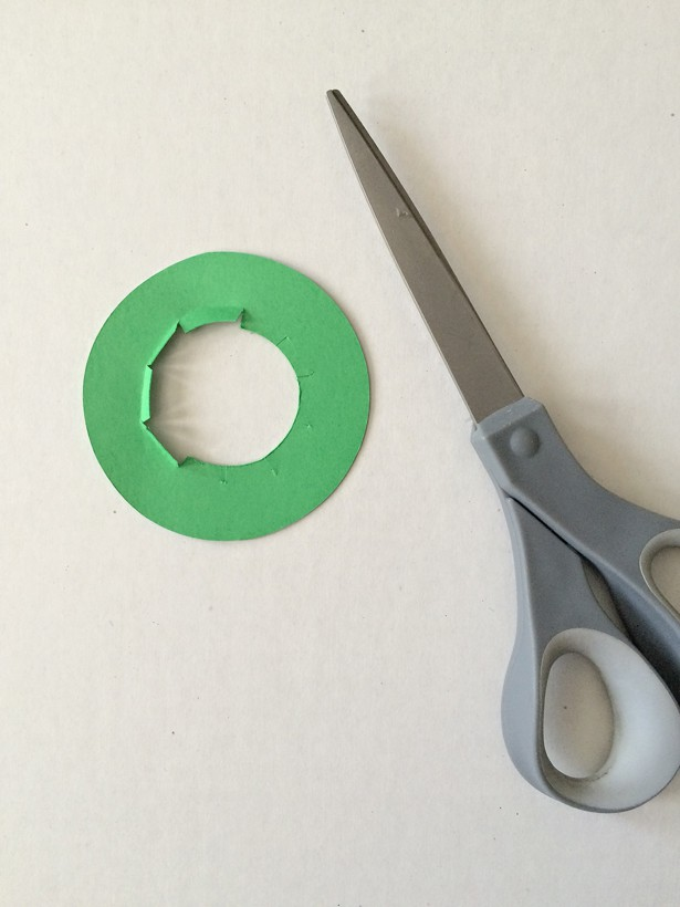 cutting out the parts for the Toilet Tube St. Patrick's Day Leprechaun Hat
