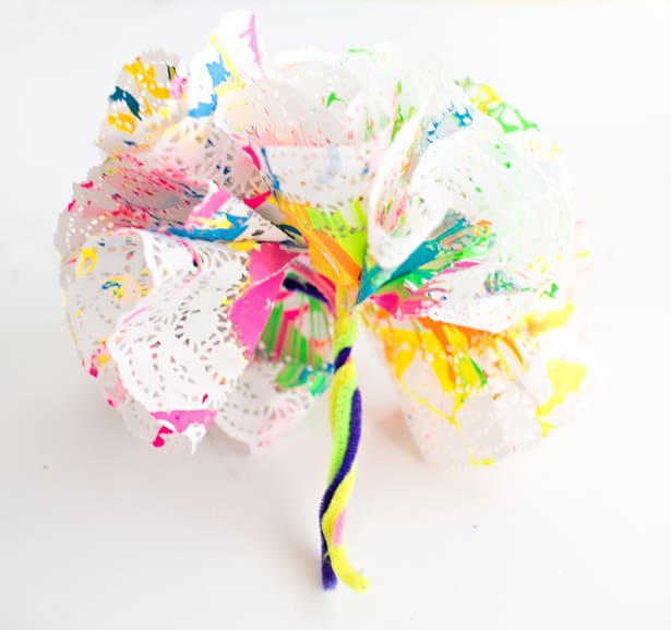 How to make spin art doily paper flowers to turn the flowers into a bouquet simply twist the pipe cleaners together arent these gorgeous the kids loved making these paper doily flowers and the mightylinksfo