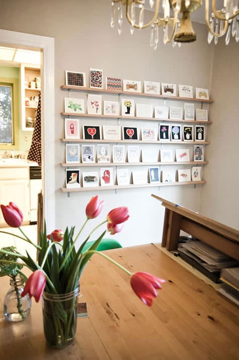 String and clothespins are an easy way to hang and switch out photos  without the fuss