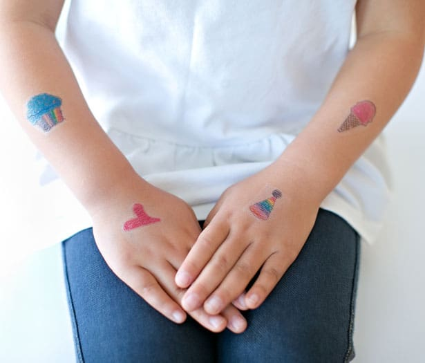 And there you go, easy DIY temporary tattoos out of your kid's art! My daughter had so much fun making her own tattoos and then showing them off.