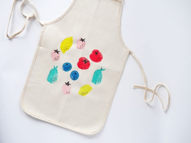 But the rule in our home, is if you help prepare the meal you wear an apron. {That's probably the high school Foods Teacher in me.} That's why we put together this free child's apron pattern.