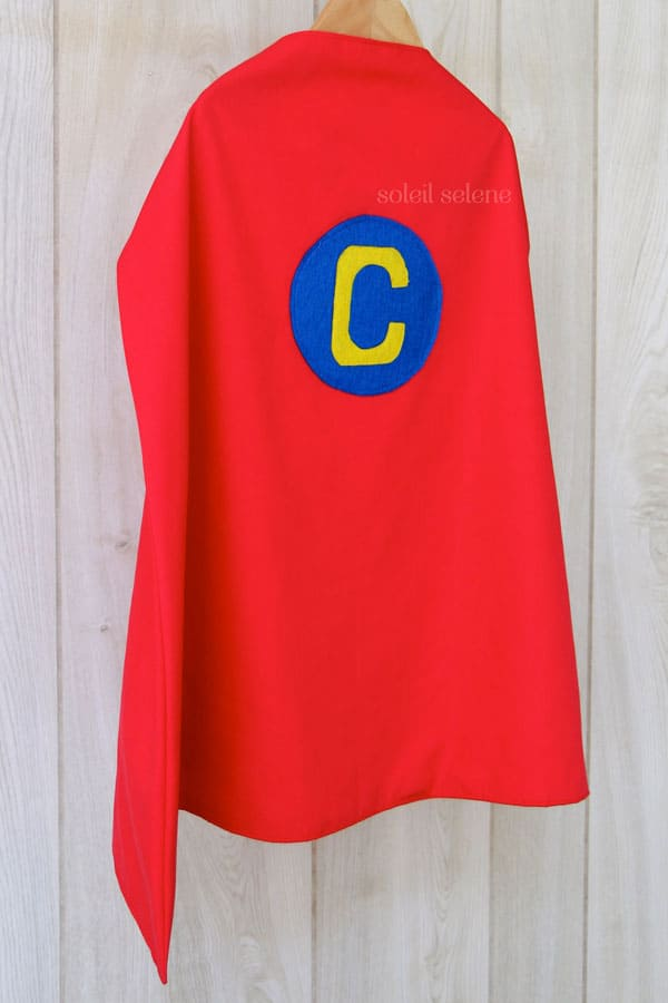 8 easy diy superhero capes simple monogram via soleil selene personalize it with a superman inspired monogram on a fire engine red cape maxwellsz