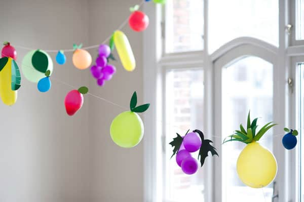 0256d08ff8b6 Fruit Garland (via Oh Happy Day) Kids love balloons and will get a big kick  out of these festive fruit shaped ones that look good enough to eat.