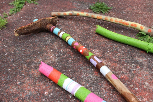 Painted Walking Sticks Via The DIY Dreamer Give Kids Their Own Fun To Poke Around Nature Which They Can Paint And Decorate Themselves