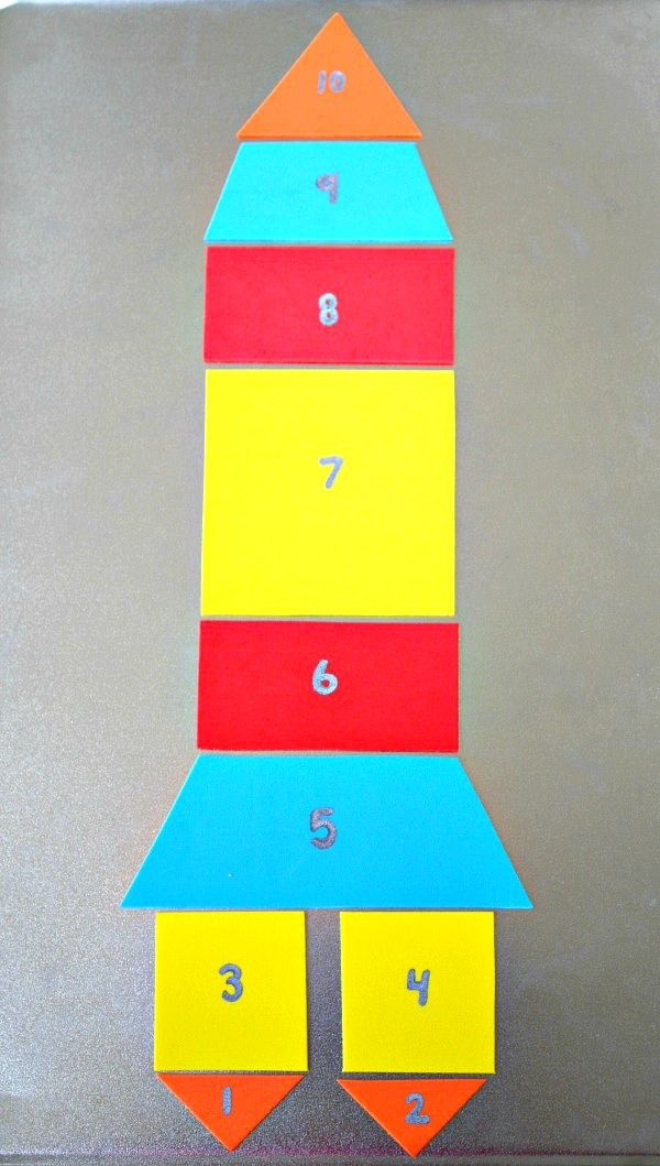 DIY MAGNETIC ROCKET PUZZLE AND MATH GAME on 50 Spring Crafts Activities