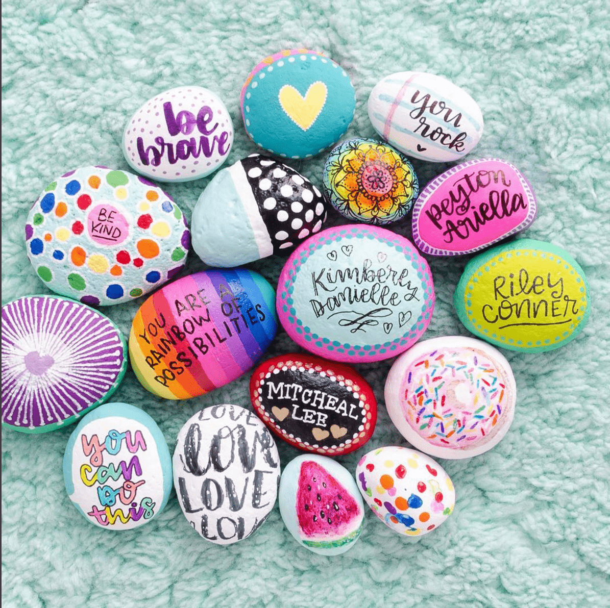 10 inspiring painted rocks for spreading kindness for Spray paint rocks for garden