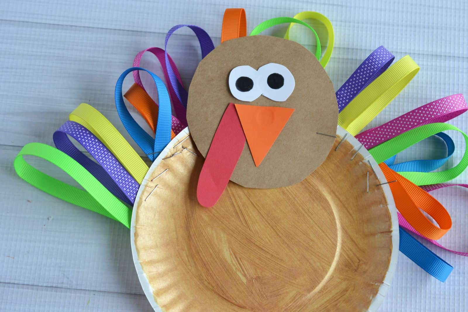 10 artsy turkey projects kids can make to celebrate thanksgiving doily turkey craft via i heart crafty things what a clever use of doilies let kids decorate these decorative papers to make colorful feathers jeuxipadfo Images