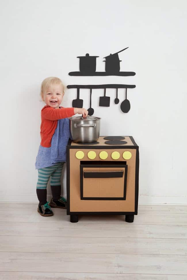 cardboard play kitchen via pimpelwit turn a large cardboard box into a stove and voila youve got a kitchen i love the black construction paper cutouts - Play Kitchen