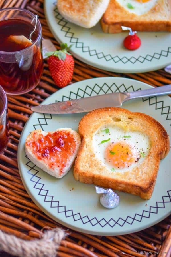 give eggs and toast a valentine makeover with a cute heart cut out and fill the other half with jam to make it even sweeter