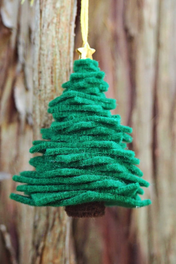 This adorable felt Christmas tree ornament will look so festive up on your tree. And it's easy to make with just pieces of felt so kids can help make their ...