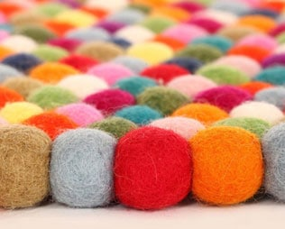 HANDCRAFTED WOOL FELT BALL RUGS FOR KIDS' ROOMS