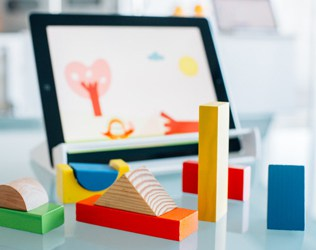 MAGIK PLAY COMBINES IPAD GAMES WITH WOODEN TOYS