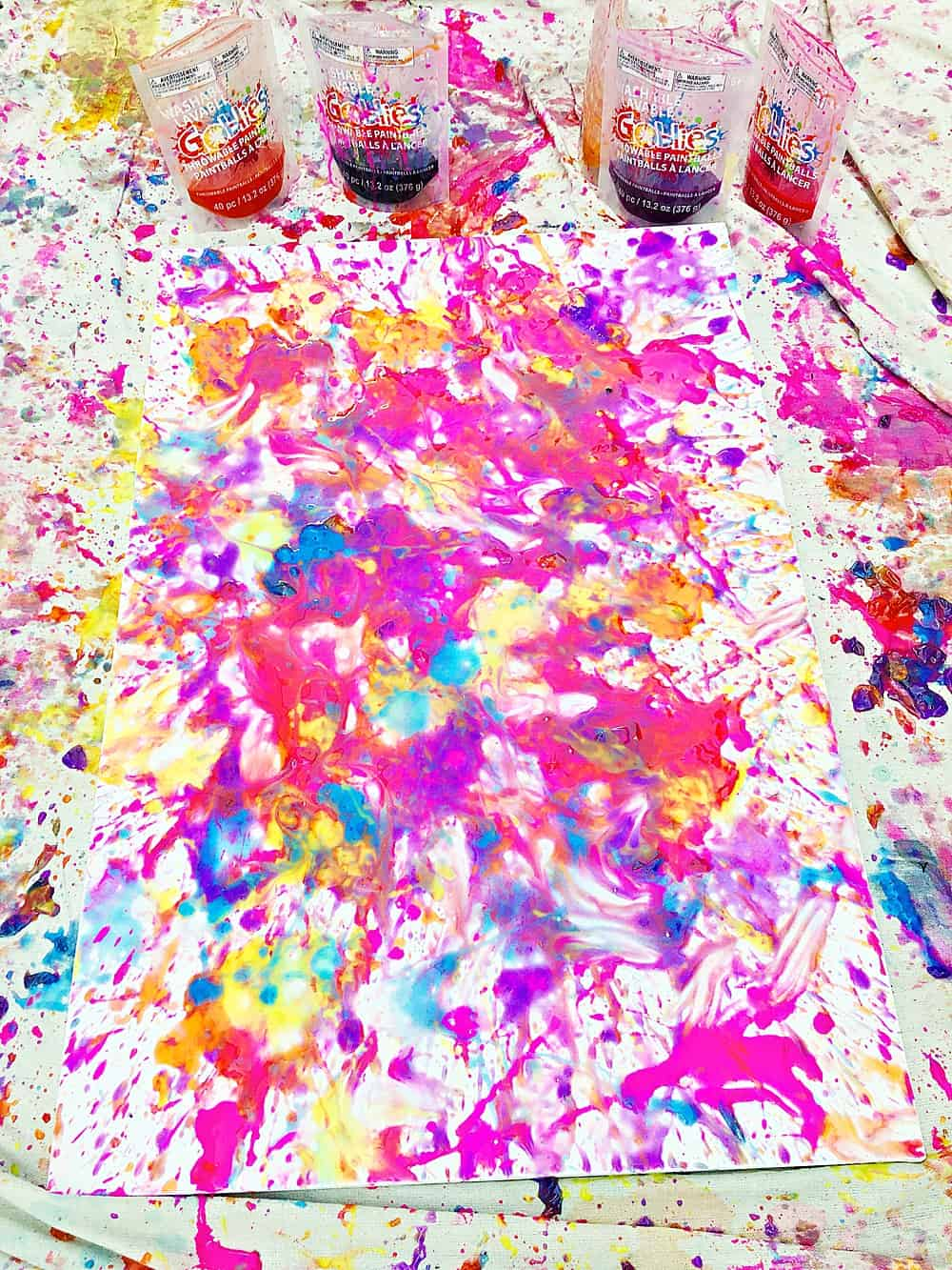 Read below to see how we set up this fun paint ball painting activity while keeping messes to a minimum