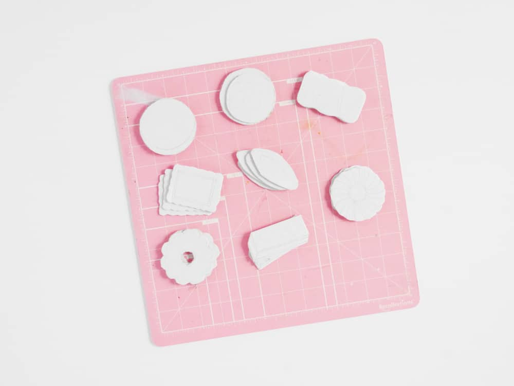 DIY your own set of adorable pretend play cookies from cardboard. A great recycled craft for kids!