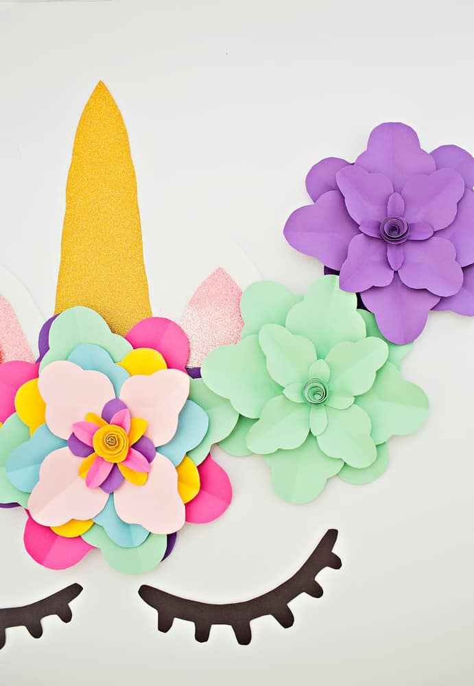 Create a beautiful and easy DIY unicorn flower backdrop for party decor!