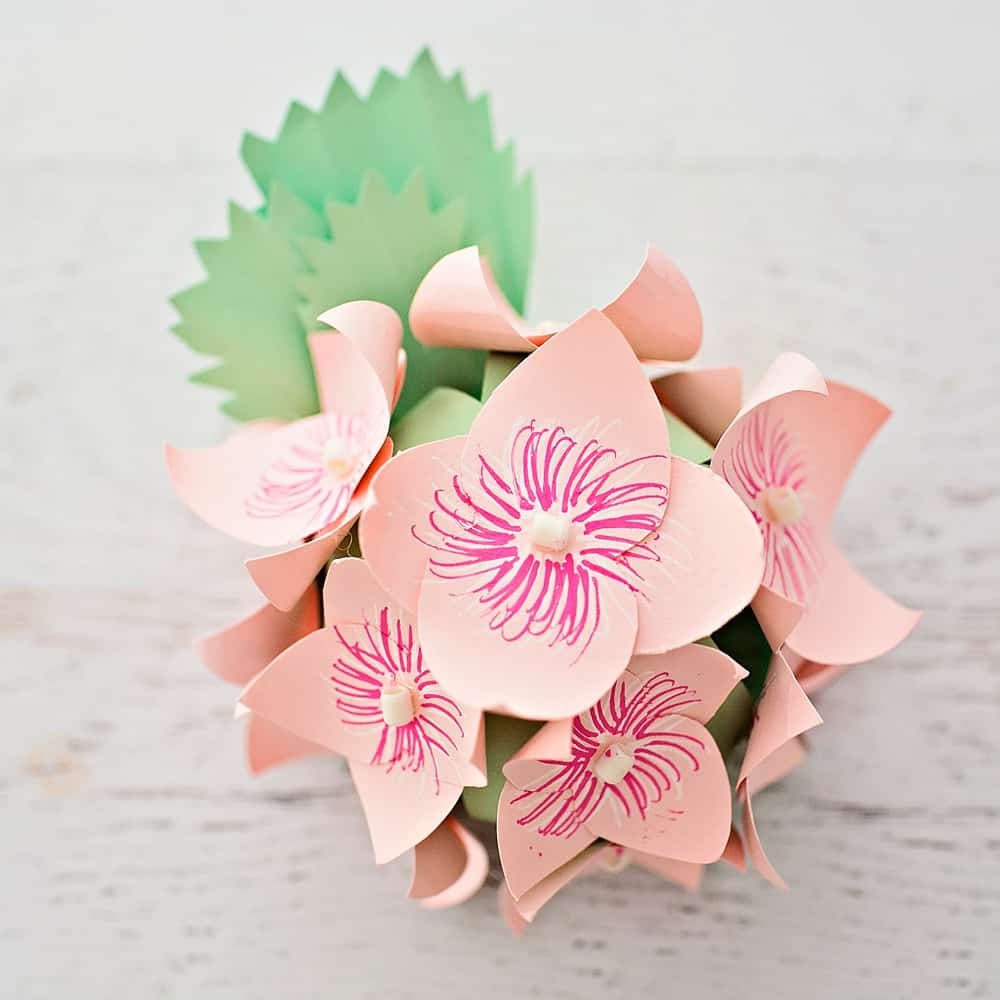 Diy paper hydrangea flowers hello wonderful what we love about paper flowers is their simplicity in materials often just gluetape scissors and paper are needed you can make them out of tissue mightylinksfo