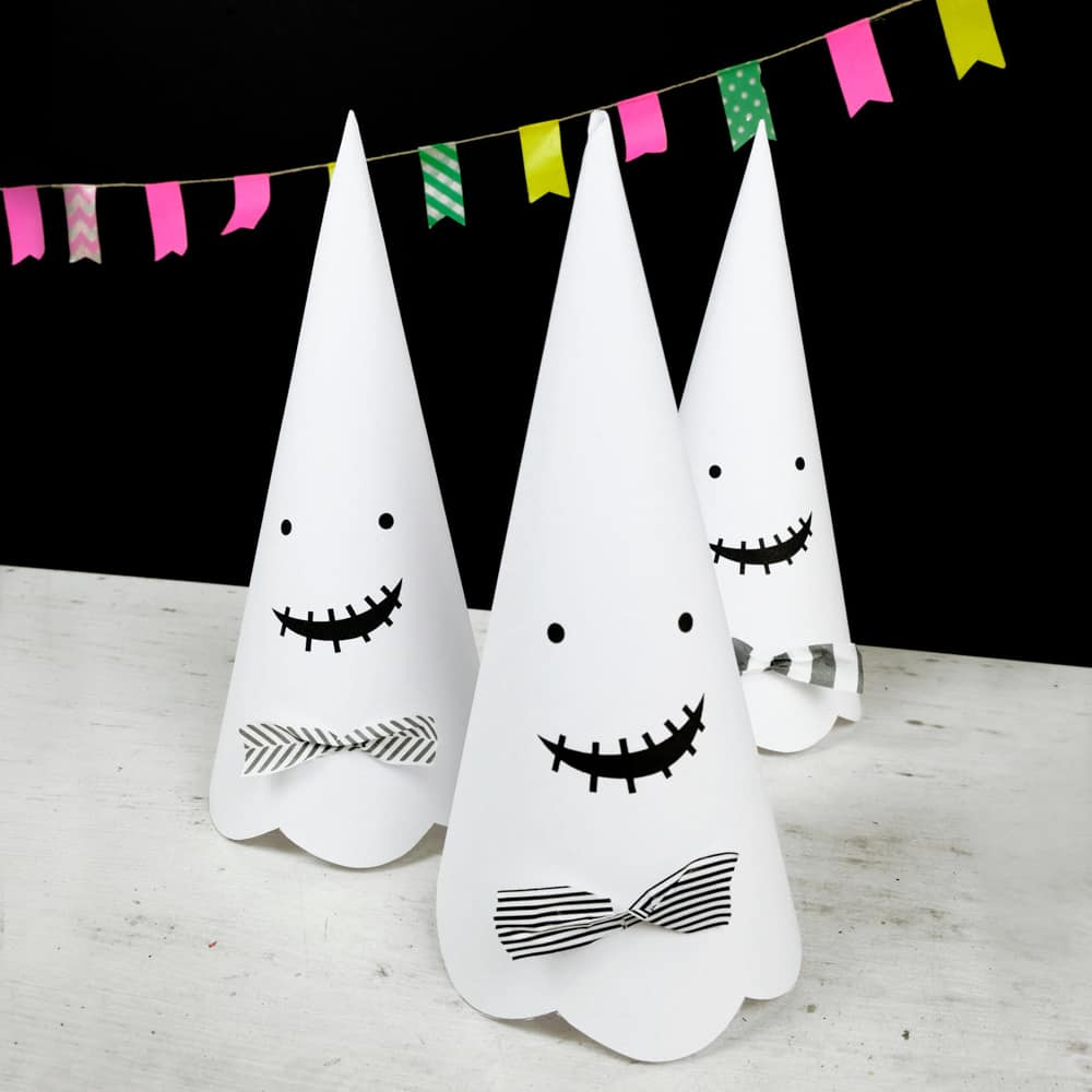 Cute Halloween paper cone ghosts (free template included).