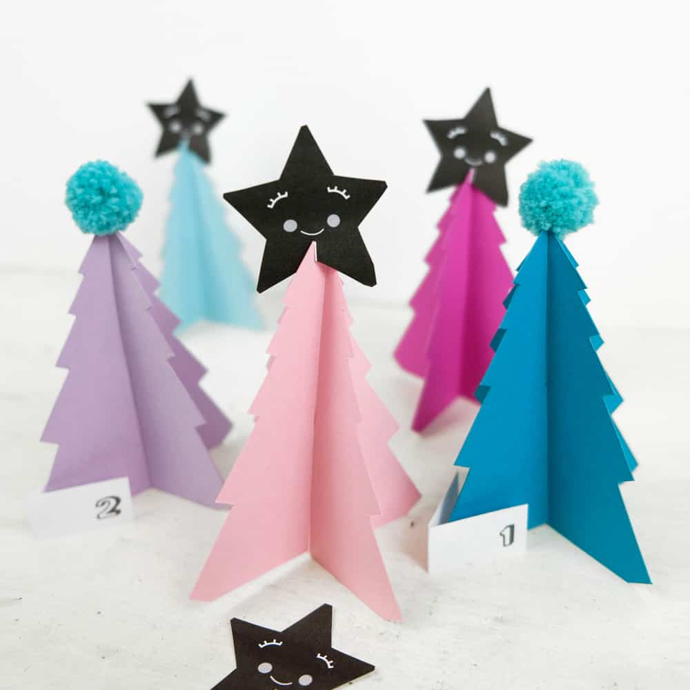 Create your own holiday countdown and use colorful pom poms to decorate these bright trees paper trees (free template included).