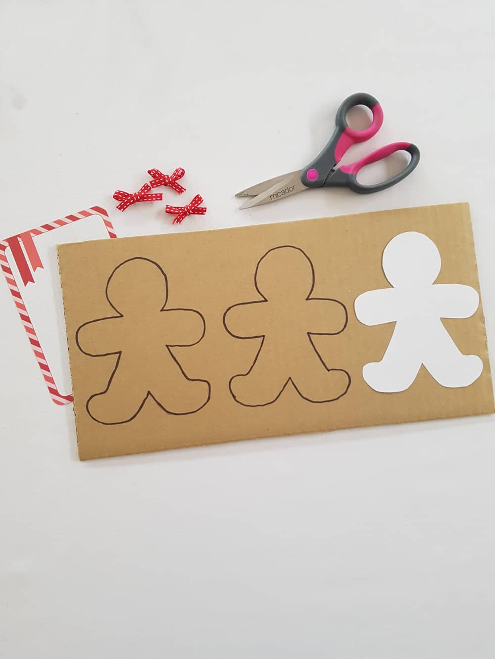 A simple gingerbread lacing activity for holiday-themed fine motor skill practice.