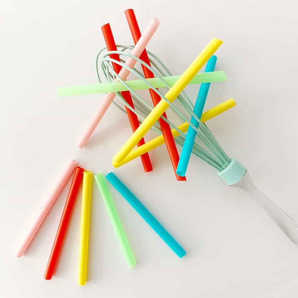 Straw and whisk baby fine motor skills sensory activity.