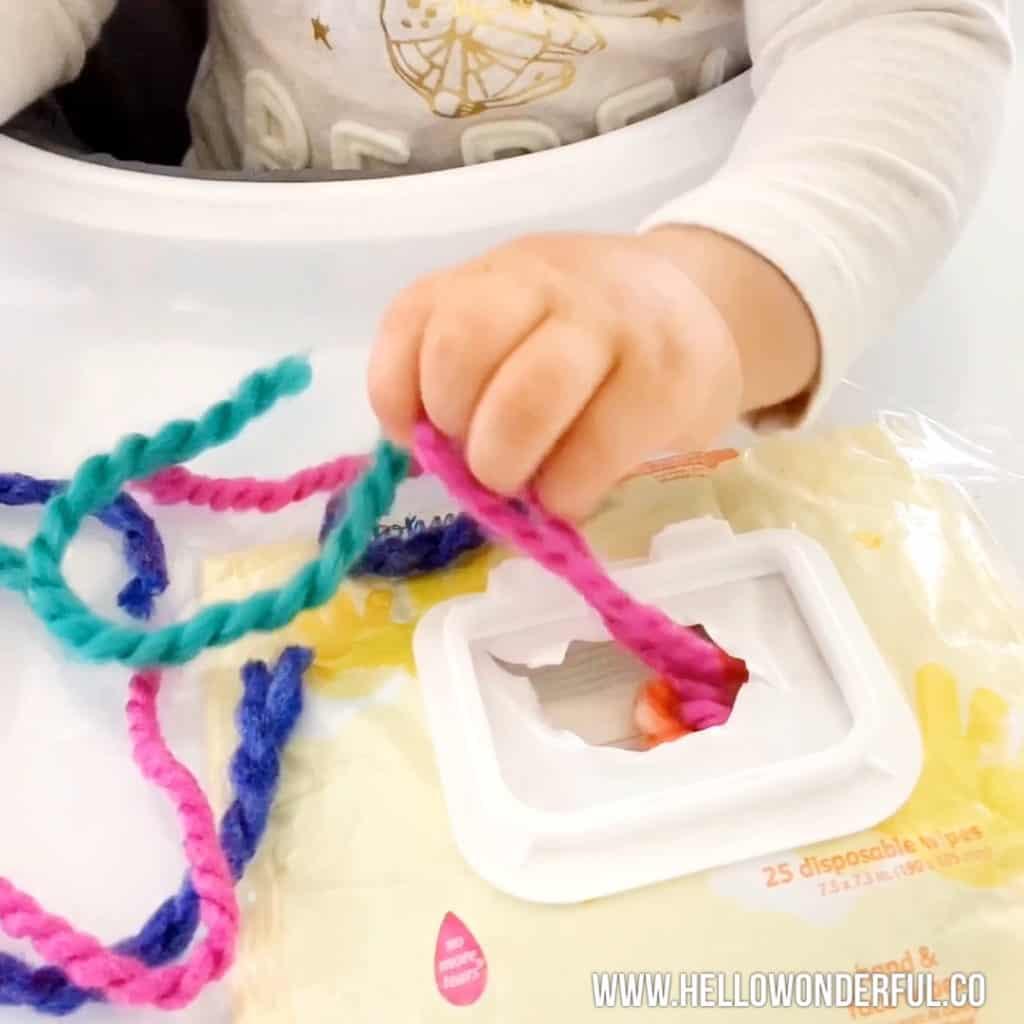 yarn pulling fine motor skills activity babies toddlers