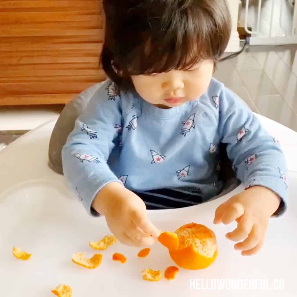 peeling oranges fine motor skills activity for babies or toddlers