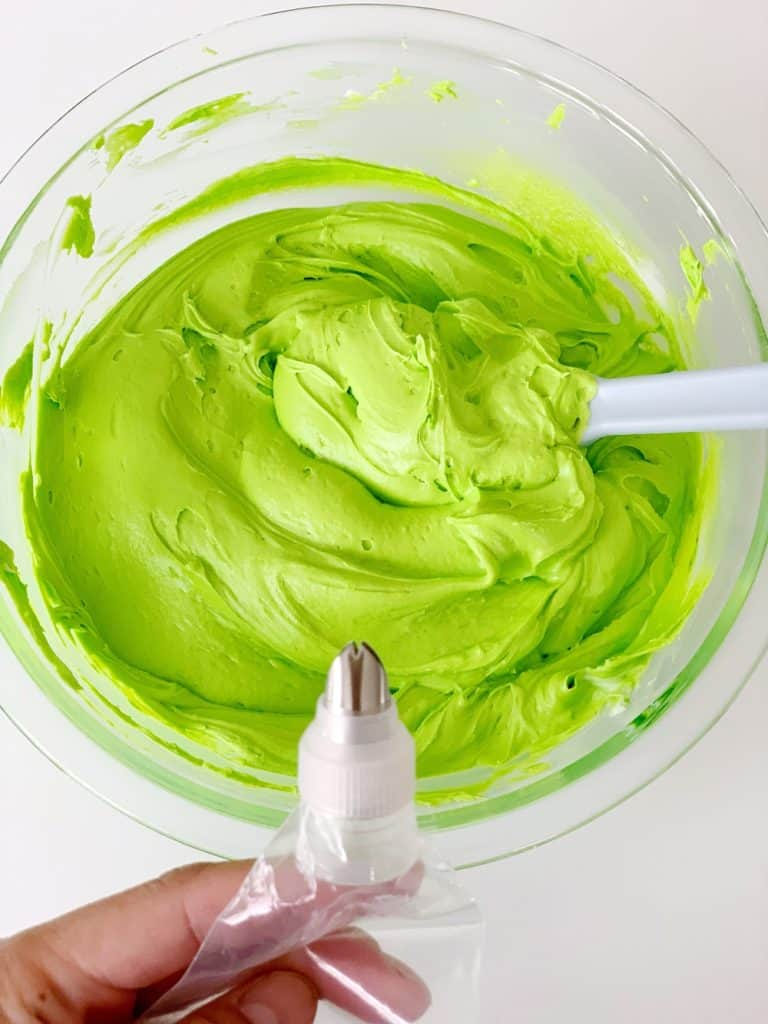 green vanilla buttercream frosting with leaf tip