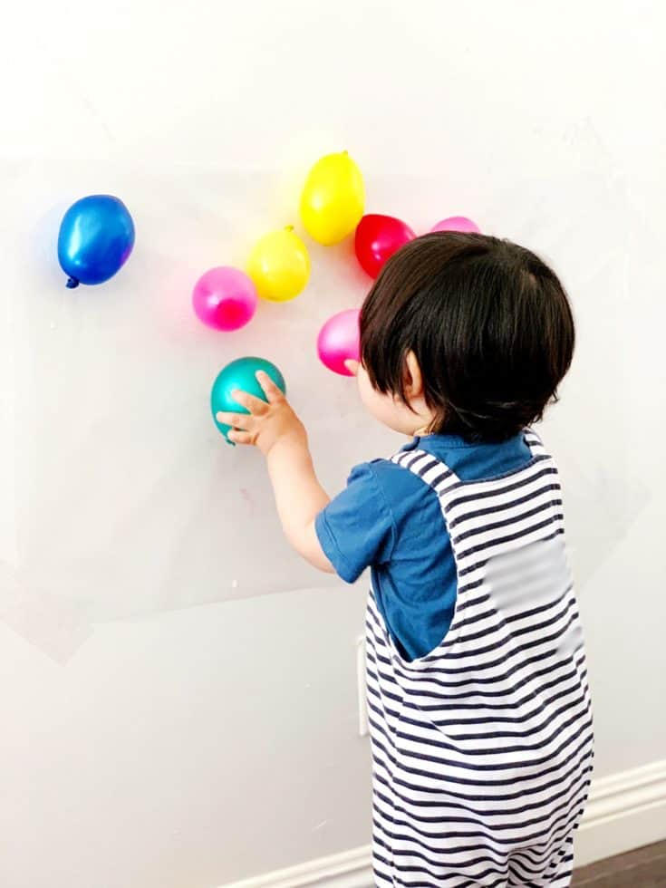BALLOON STICKY WALL SENSORY ACTIVITY FOR BABIES AND TODDLERS