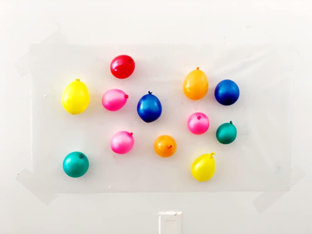 balloons on contact paper for sticky wall sensory activity
