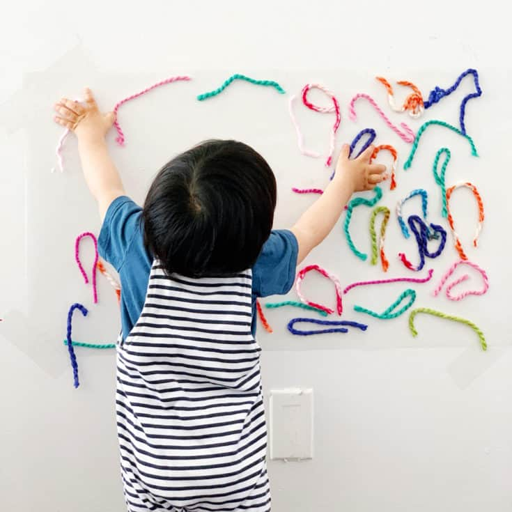 STICKY WALL YARN SENSORY ACTIVITY FOR BABIES AND TODDLERS