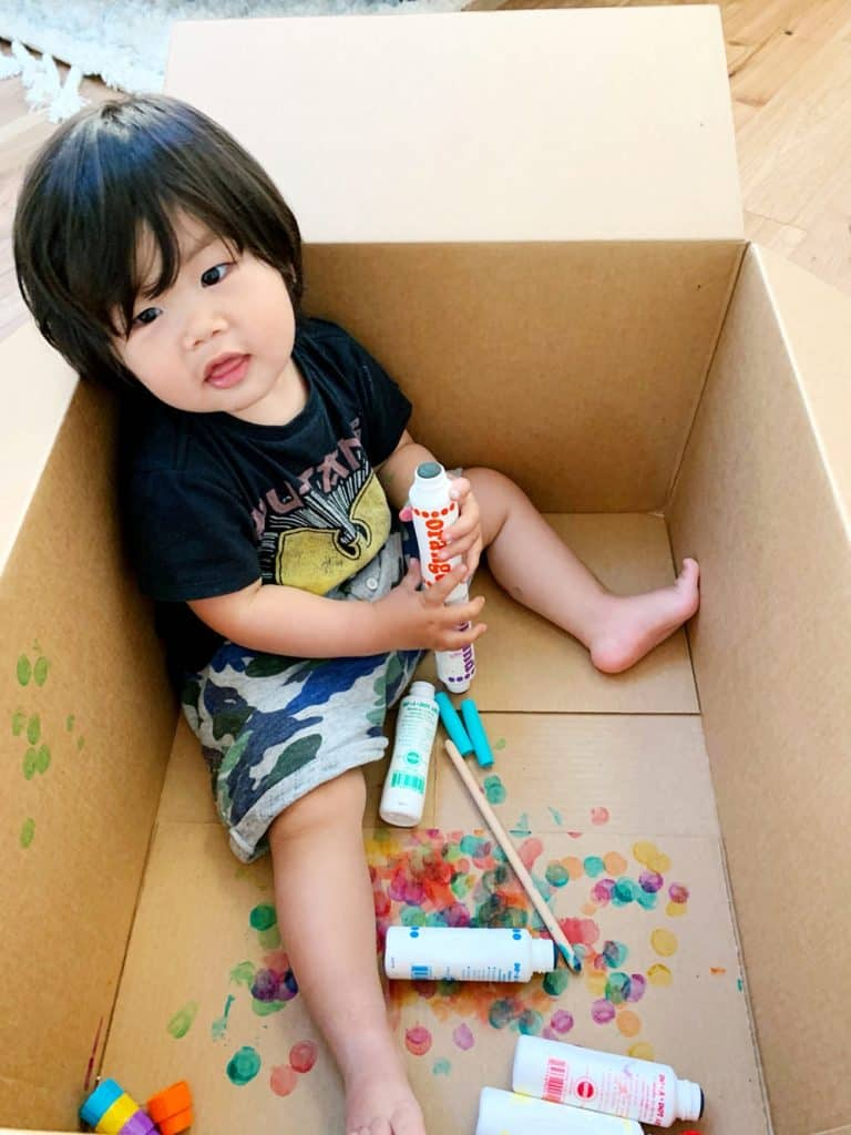 baby toddler painting in box