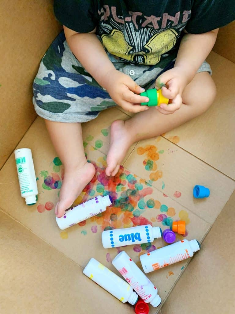 Baby Toddler Painting in a Cardboard Box