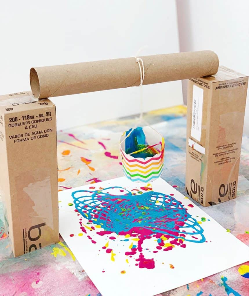 Pendulum Painting With Kids using recycled materials