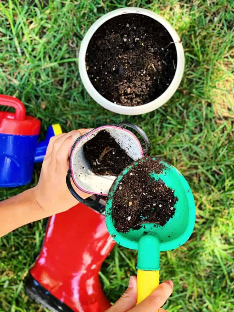 diy rain boot planters - gardening with kids