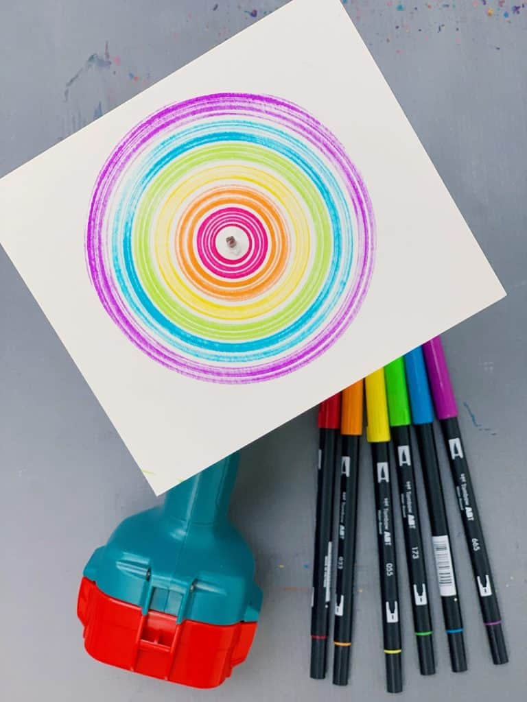 drill spin art with kids - rainbow colors