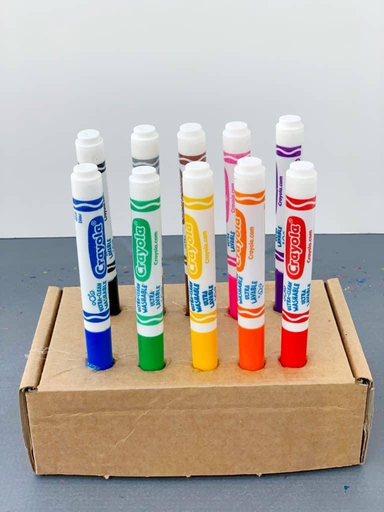 marker lid teacher classroom hack using cardboard box
