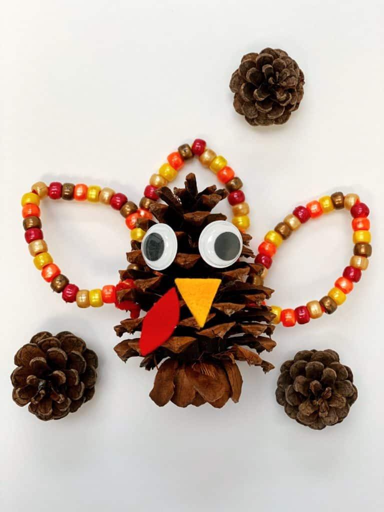 Fine Motor Pine Cone Turkey Craft Activity for kids