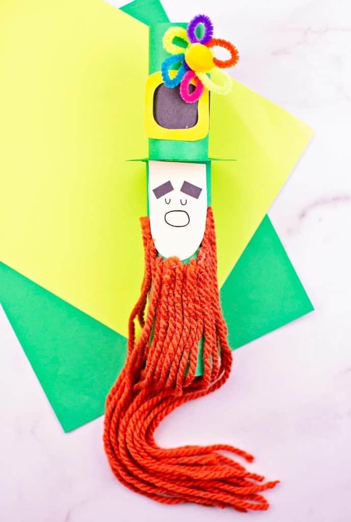 Paper tube Leprechaun craft for kids St Patrick's Day activity. Trim the leprechaun beard.