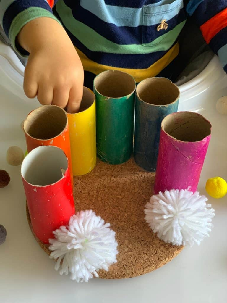 This Rainbow Pom Pom Drop Toddler Fine Motor Skills Activity