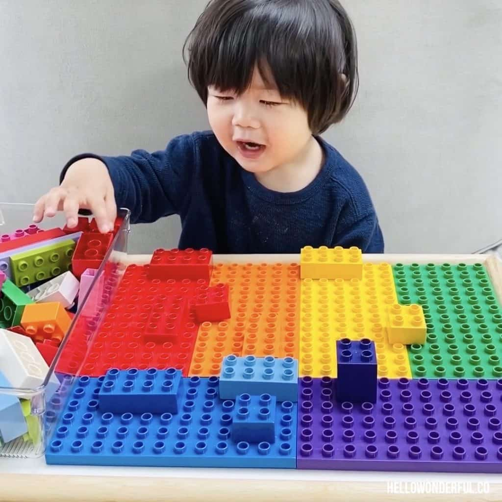 DIY LEGO Tray Table holds DUPLO too great for toddlers and preschoolers.