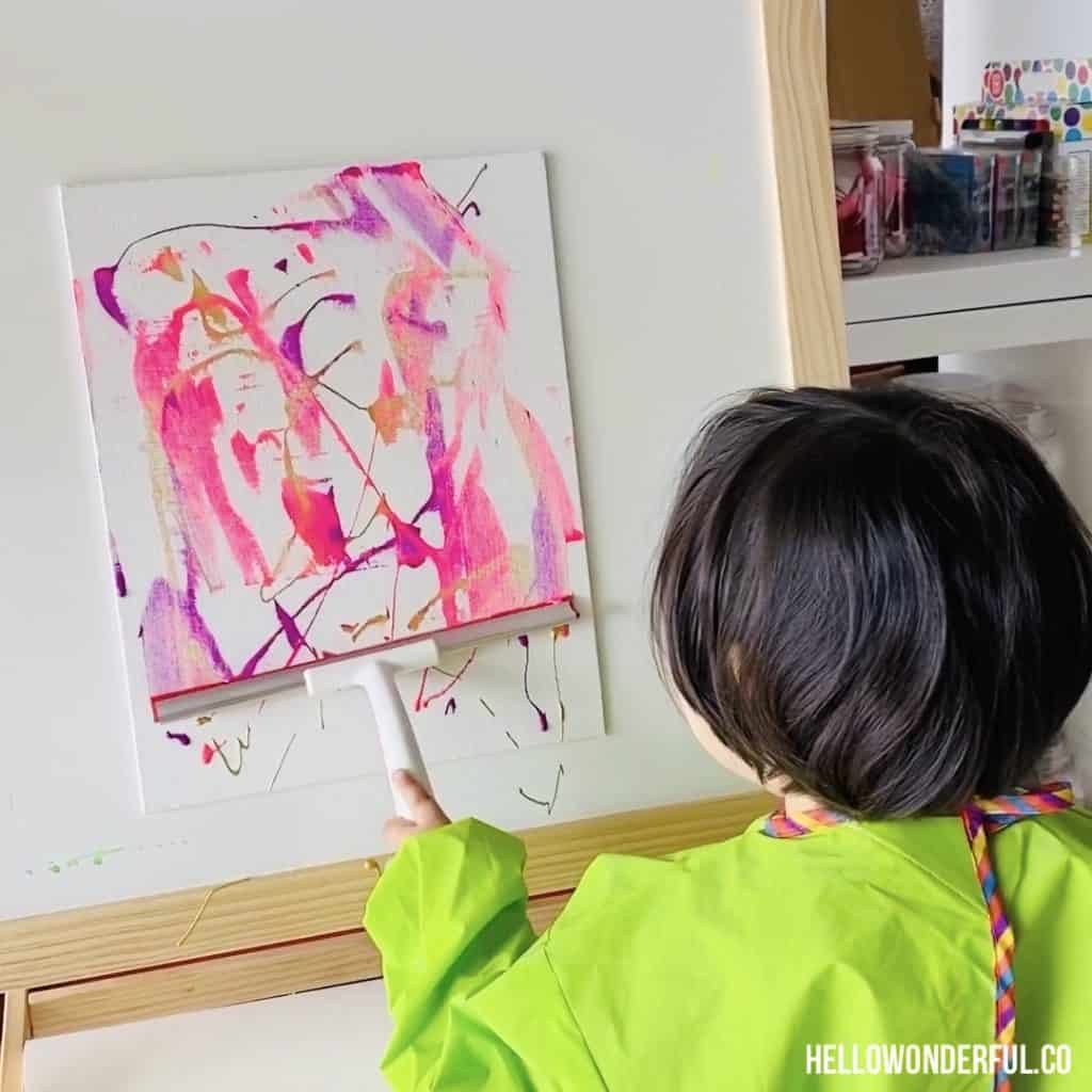 squeegee painting with toddlers. Fun low-mess painting with beautiful results