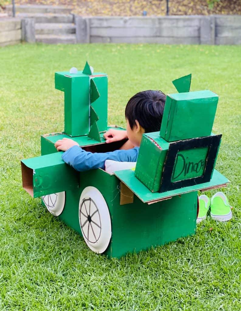 dinosaur cardboard car