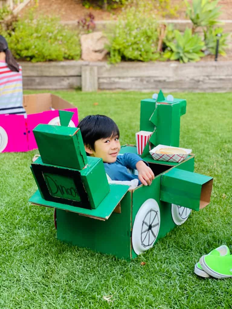 dinosaur cardboard car for outdoor movie night