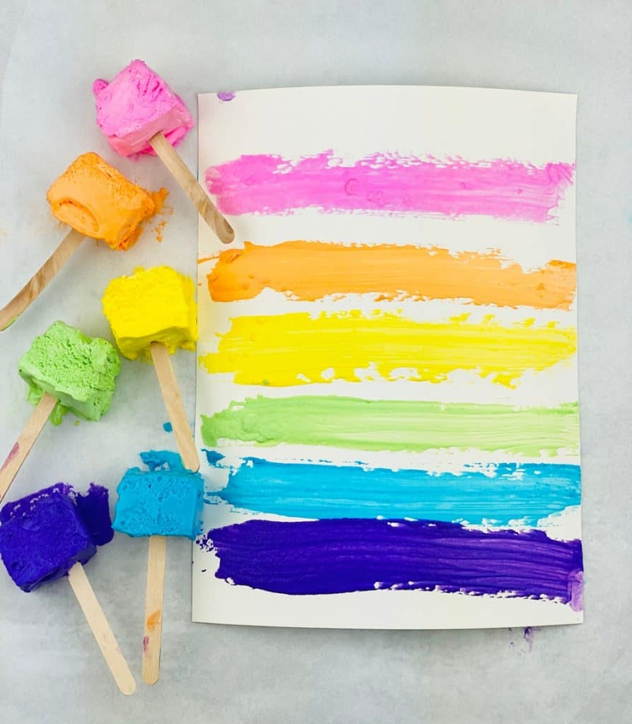 two ingredient taste safe paint made with Cool Whip. Paint on popsicle sticks and paper.