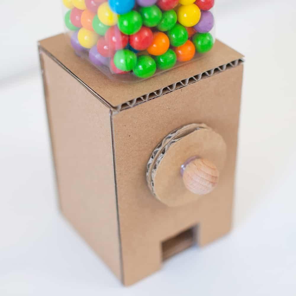 colorful gumballs inside a cardboard machine